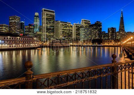 San Francisco Skyline with Holiday Lights and Reflections. Pier 7, San Francisco, California, USA.