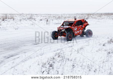 4Wd Atv Vehicle Rushes On The Snow-covered Road