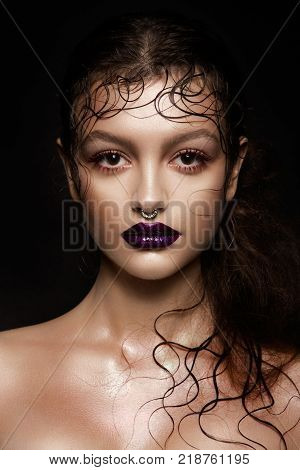 Fashion Brunette Model Portrait. Hairstyle. Professional Makeup. False Eyelashes. Purple Make-up
