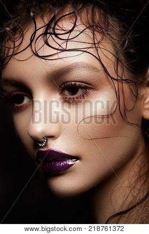 Fashion Brunette Model Portrait. Hairstyle. Professional Makeup. False Eyelashes. Purple Make-up