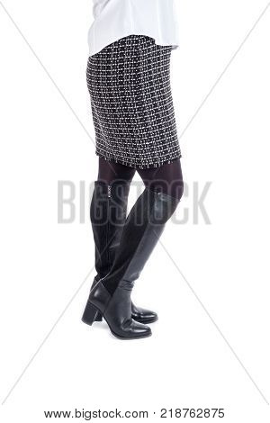 Woman Modeling New Shinny Black Knee High Boots Isolated on White