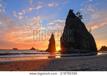 Coastline with sea stacks at sunset. Rialto Beach in Olympic National Park Olympic Peninsula near Seattle Olympia and Port Angeles. Washington. United States of America.