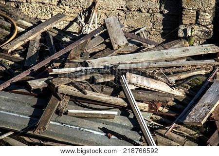 A garbage dump of waste beams. Old dried beams are waiting for reuse. poster