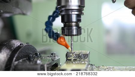 Milling cutting metalworking process. Precision industrial CNC machining of metal detail