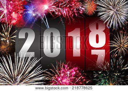 Counter changing year 2017 to 2018 with fireworks display. Happy new year concept.