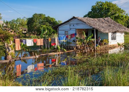UDAPPUWA, SRI LANKA - JANUARY 18, 2011: Clothes drying in the sun at poor farmers' house on a flooded area. Udappuwa is a populated place in Sri Lanka with an average elevation of -3 meter below sea