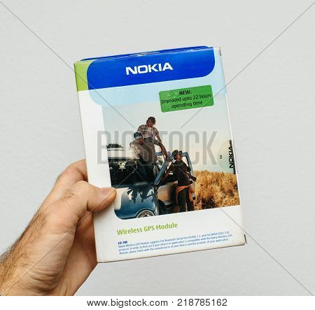 PARIS FRANCE - DEC 18 2017: Man holding against white background vintage and luxury NOKIA box of a Wireless GPS module