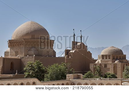 Ancient center of Yazd town in Iran mud brick architecture Friday mosque and traditional old bazaar.