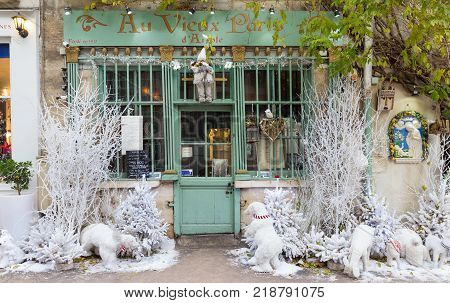 Paris, France-December 17, 2017 : The old traditional French cafe Au vieux Paris d'Arcole ecorated for Christmas located in a touristy area, near Notre Dame cathedral, on Cite island.