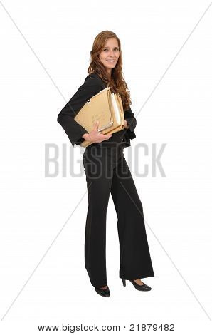 Businesswoman In A Suit Wearing Stacks Of Files