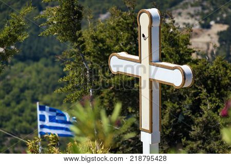 Cross and Greek flag in front of Tsambika Monastery (RHODES GREECE)