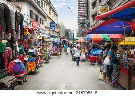 MANILA, PHILIPPINES - APR 1, 2016. People at street market in Manila on Apr 1, 2016,  Philippines. Manila is the capital of Philippines and the most densely populated city proper in the world.