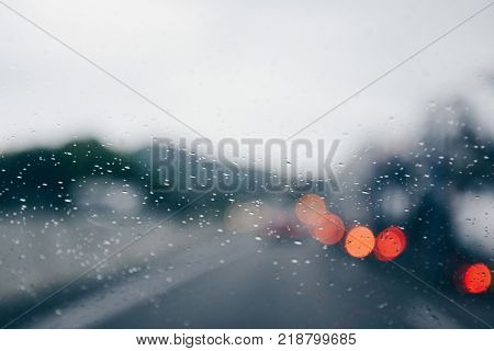 Dangerous blurry driving car in the rainy weather on slippery road