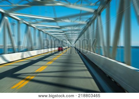 Highway bridge tunnel over water with motion blur concept