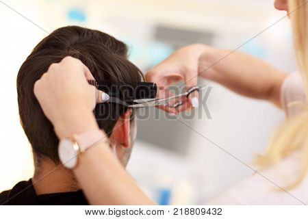 Picture showing adult man at the hair salon