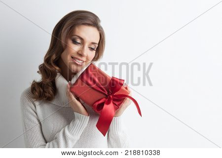 Woman hold christmas or new year decorated gift box