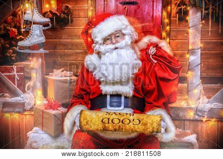 Santa Claus is preparing for Christmas, he reads a list with children's desires. House of Santa Claus. Christmas decoration.
