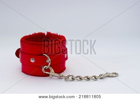 Bondage Sadomasochism sex games erotic handcuffs for sex. Handcuffs on a gray background