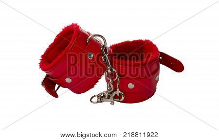 Red leather handcuffs. Isolated handcuffs on a white background