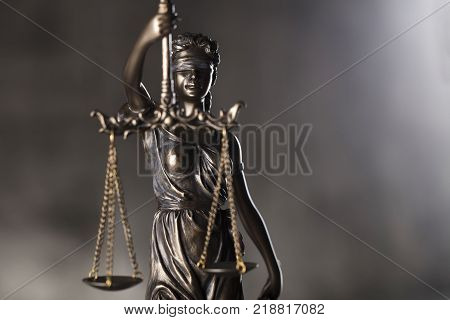 Courtroom concept. Blind justice - Themis. Gray stone background. Place for typography.
