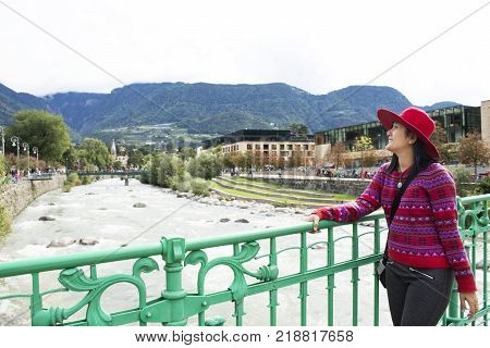 Thai Women Travel And Posing For Take Photo With Passer River At Maran City In Merano, Italy