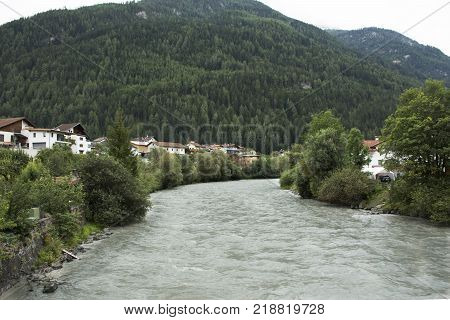 Flowing and motion of water very fast from rainstrom in Bad inn river at Pfunds village in evening time in Tyrol Austria