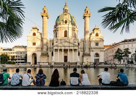 Vienna, Austria - August 15, 2017: Karlskirche or Church of St Charles is a baroque church located on the south side of Karlsplatz in Vienna. Unidentified tourists enjoying the views