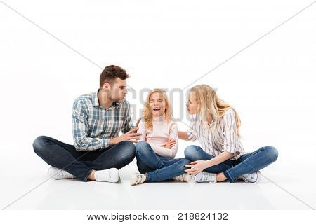 Portrait of a angry family sitting together and having an argument isolated over white background