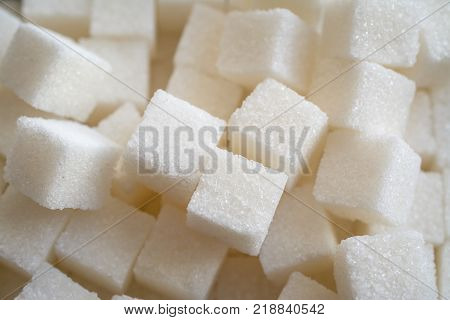 Close up shot of white refinery sugar. Food concept.