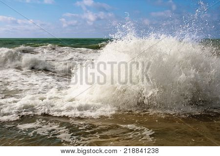 Waves of the Caspian Sea are fighting on the rocky shore