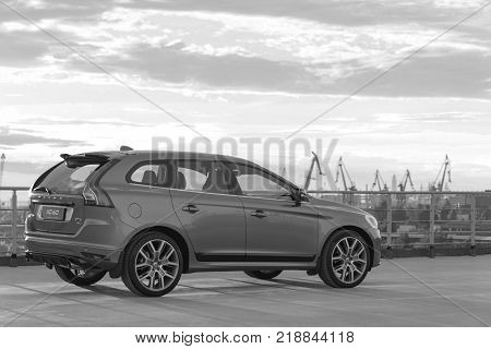 St. Petersburg Russia - June 17 2017: A modern luxury swedish car Volvo XC60 R-Design Polestar Edition on the roof of the building. Black and white