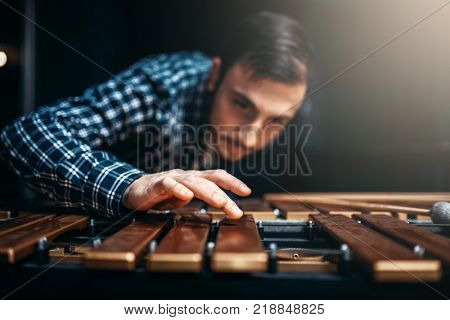 Xylophone player with sticks, musician in action