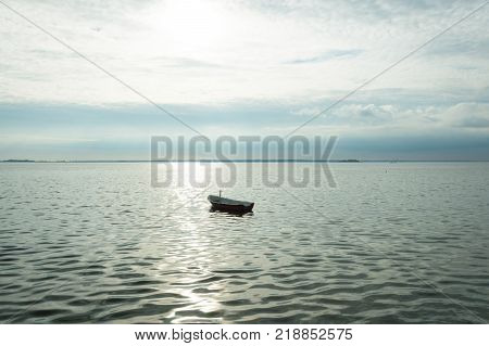 Alone Boat On Denmark Fyord On Sea With Cloudy Sky