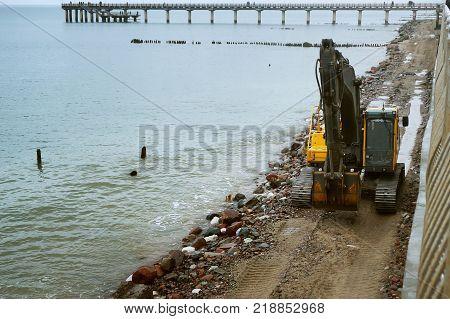 the construction of coastal protective structures construction of structures to protect against sea waves beregost construction equipment at sea beach facilities construction of quay