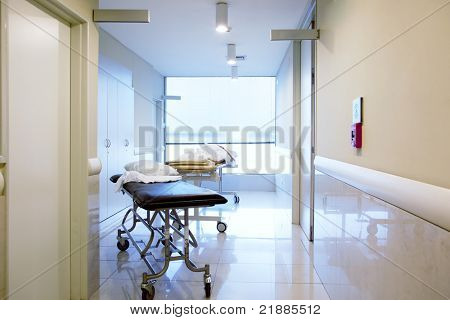 An intrior of a hospital hallway with a couple stretchers