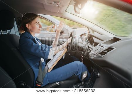A woman feels stress on the road. Big Traffic jams. Business woman is late for work.