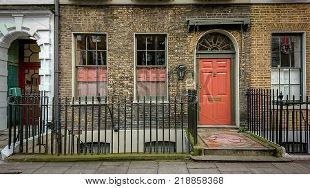 LONDON UK - 18 DECEMBER 2017: The front entrance to a row of typical London Georgian Town Houses. The houses are on the same street as the author Charles Dickens once lived.