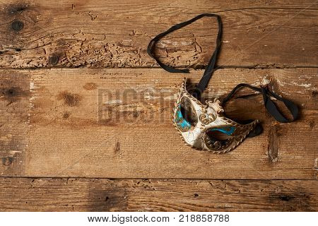 venetian carnival mask on a wooden table
