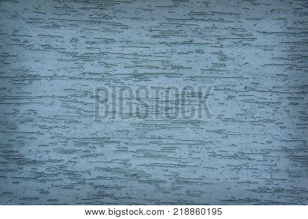 Horizontal turquoise plaster grunge wall background with darkened edges. Overlay grainy texture for your design. Brown decorative stucco with craquelure