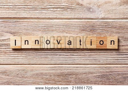 INNOVATION word written on wood block. INNOVATION text on table concept.