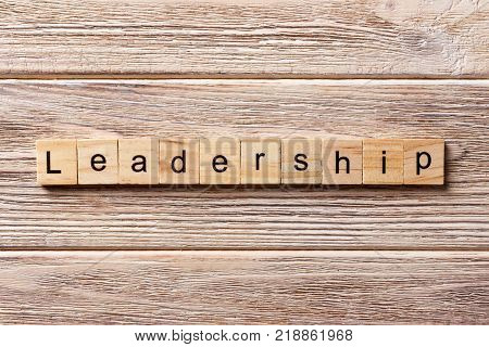 LEADERSHIP word written on wood block. LEADERSHIP text on table concept.