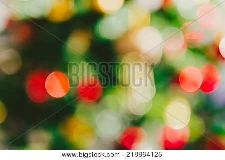 unfocused bokeh of colorful lights on Christmas tree