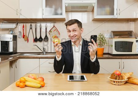 Perturbed Young Business Man In Suit, Shirt, Having Breakfast, Sitting At Table With Tablet, Spreadi