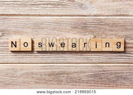no Swearing word written on wood block. no Swearing text on table concept. poster