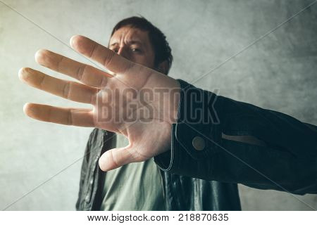 Celebrity male hiding face with hands from paparazzi photographers no photos gesture poster