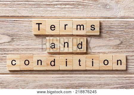 Terms and condition word written on wood block. Terms and condition text on table concept.