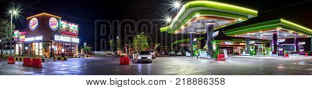 BANGKOK THAILAND - DECEMBER 19: Fast food restaurant Burger King and petro station Bangchak provides 24 hour service in Bangkok on December 19 2017.