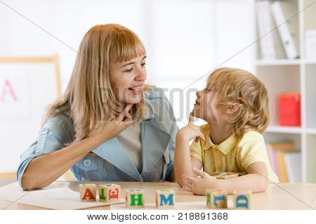 Woman teacher and kid boy on private lesson