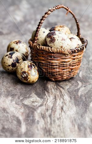 Quail eggs in a small wicker basket