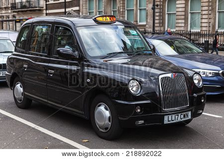 London United Kingdom - October 29 2017: Black taxi cab by The London Taxi Company is on the street